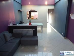 OPTION ! Maison moderne, dans un endroit calme, totalement isolée, 3 chambres (poss 4) et terrasses. Composition : au s/sol : 1 cave sur du gra