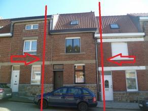 Maison d'habitation avec grand jardin, terrasse, 2 chambres, en bon état & offrant une bonne situation. Composition : - ss-sol : cuisine &e