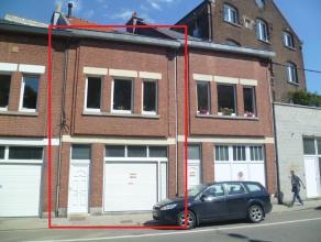 """Petite maison d'habitation de type """"bel-étage"""", avec garage, deux chambres. Composition : - sous-sol : caves sous une partie ; - rez : garage a"""