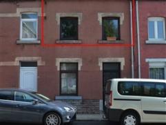 A proximité immédiate du centre ville, un appartement duplex (1er et 2ème) comprenant hall, living, cuisine super équip&ea