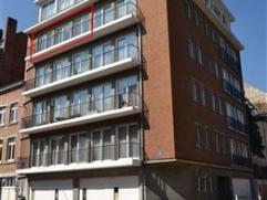 En plein centre, dans une résidence bien tenue, un appartement au 4ème étage, avec une superbe vue sur la Citadelle, la Sambre et