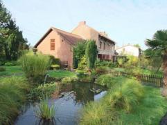 A la recherche d'une réelle propriété aux portes de Charleroi mais au calme de la campagne ? Celle-ci n'attend que votre visite!