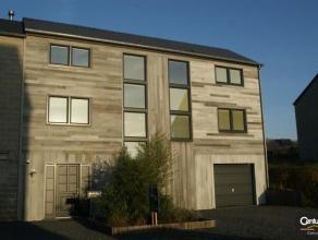 Maison récente, à ossature bois, avec rez-de-chaussée en construction traditionnelle. Jolie maison  caractérisée pa