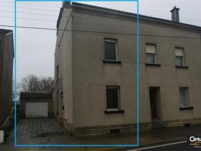 Maison à rénover disposant d'un jardin, d'un vaste garage et d'un grenier aménageable; séjour, cuisine, annexe, 2 chambres