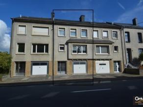 Maison bel-étage située au centre d'Arlon et disposant d'un jardin; vaste séjour, véranda, cuisine équipée r