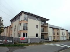 Thomas et Piron vous propose 5 appartements de 60 à 115 m² comprenant hall d'entrée, cuisine, salon et salle à manger, 1 &ag