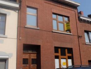 Jemappes, Rue Mac Donald 32. Spacieuse Maison Bourgeoise comprenant : un hall d'entrée, un séjour ( 36m²), une salle à mange