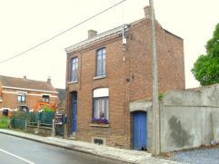 Situé à proximité de toutes commodités, cette maison de 90m² est composée au rez-de-Chaussée, d'un hall