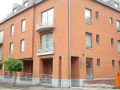 Rue Achille Legrand 18/B01. Dans nouvelle résidence. Appartement de standing sis au rez (+/-100 M²) comp. hall, séjour, cuisine &ea