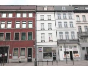 Mons rue Léopold II 8. Immeuble commercial et privé. Comp. caves, magasin 60 M² avec petite réserve et wc.1er ét: hal