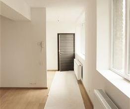Situé dans une ancienne école, nous vous proposons cet appartement 1 chambre avec parking privé dans une résidence enti&eg