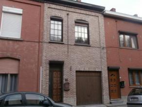 Très belle maison mitoyenne de deux chambres avec garage! idéalement située, son grand ensemble salon-salle à manger-cuisi