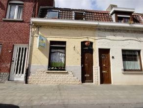 Coquette maison d'habitation située à la place d'Herseaux Ballons, le rez-de-chaussée se compose d'un spacieux living, d'une sall
