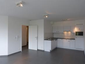 Aangenaam en volledig geschilderd appartement in het hartje van Gent. Via de leefruimte heeft en een prachtig zicht op de Sint-Michielskerk.<br /> <br