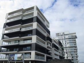 Prachtig nieuwbouw 2 slaapkamer appartement gelegen op de Oesteroever te Oostende. Living in parket met veel lichtinval en open ingerichte keuken met