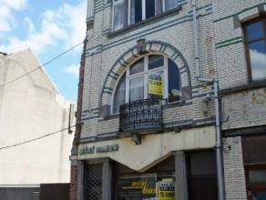 Dendermonde, Bogaerdstraat 13-15.Ruim, centraal gelegen, totaal te renoveren burgerhuis (combinatie woonst-winkel). Unieke gevel met art-nouveau invlo