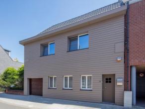 Landelijk ingerichte woning met een bewoonbare oppervlakte van 213 m in het centrum van Bornem. De cottage-stijl, die de woonkamer siert, is doorheen