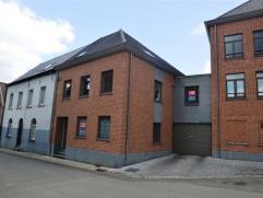 Appartement triplex neuf à Frasnes-lez-Buissenal qui développe 147 m² et se compose de: hall, buanderie, wc, grand living (40 m&sup