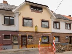 Te renoveren gesloten bebouwing op enkele kilometers van centrum Oudenaarde, met uitweg achteraan. Gelegen nabij de vlotte verbindingsweg N60 (Gent-Ou