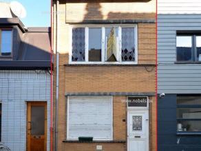 Vlot bereikbare woning met 2 slaapkamers te Gent. Interessant voor de klusser of voor wie op zoek is naar een goede investering! Indeling: Inkom, woon