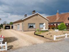Open bebouwing op 1295m², living, keuken, badk, 3 slaapk, berging, kelder, waspl, ruime zolder, veranda,  tuin, terras, garage, goed gelegen en g