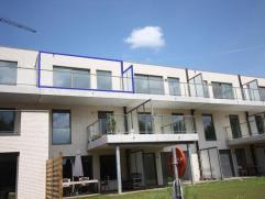 Penthouse met zicht op de Leie! Prachtige nieuwbouwpenthouse met zuidgeoriënteerd terras en zicht op de Leie. Indeling: ruime living met veel lic