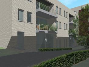 Exclusief appartement te Leuven, omvattende : een ruime inkomhal met apart toilet, een leefruimte met open geïnstalleerde keuken en aansluitende