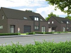 Prachtige moderne halfvrijstaande woning op 3 are 37 ca met op het gelijkvloers een ruime inkomhal met een apart bezoekerstoilet en een inpandige gara