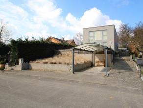 Een instapklare en recente woning (2004), zeer rustig gelegen in het groen te Temse. IND: GLV: lichtrijke leefruimte(27 m²) met zicht op terras(2