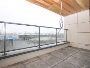 Goed gelegen, ruim en mooi afgewerkt nieuwbouwappartement in het centrum van St-Niklaas. Ind.: GLV: Gemeenschappelijke inkomhal met lift en toegang to