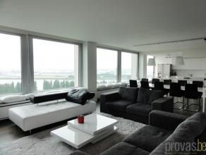 Ruim en volledig gemeubeld appartement van ca 190m² gelegen op linkeroever met een fenomenaal panoramisch uitzicht op Antwerpen. Het appartement