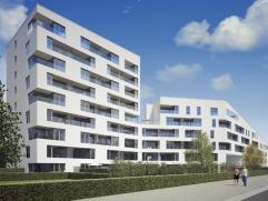 Appartement op de eerste verdieping met een oninneembaar uitzicht over de Brugse Vaart vooraan en over een aan te leggen park achteraan. Gelegen op 5