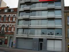 2-slaapkamer appartement nummer 5.2 gelegen op de 5de verdieping in de Residentie Sea Horse, bevat inkom, afzonderlijk toilet, zonnige living, moderne