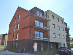 Superbe appartement de haut standing idéalement situé et se composant d'1 chambre avec placard, beau living, cuisine équip&eacute