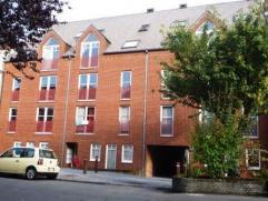 Avenue de Saint Pierre 27 à 7000 MONS. Appartement situé au premier étage de l'immeuble et composé de: living, coin cuisin