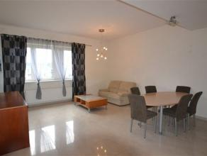Bel appartement composé comme suit: hall d'entrée, séjour, cuisine équipée, chambre, salle de bain, coin dressing,