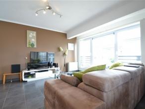 Très bel appartement de 86 m² composé comme suit: hall d'entrée, séjour ouvert, cuisine équipée, arri&e