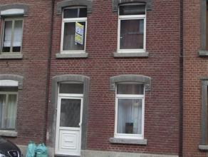 A DISON, belle petite maison de rangée. Elle se compose de : au sous-sol, un hall donnant l'accès à la terrasse et au jardinet, u
