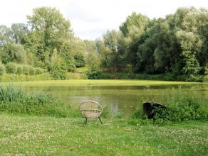 """Deze unieke historische eigendom is gelegen op een vier hectare groot groen domein """"De Campomolen"""" met twee private vijvers in Asbeek in een van die z"""