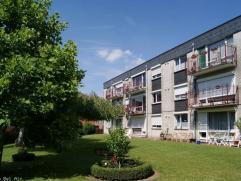 A proximité de l'autoroute et centre de Mons, dans l'entité de Cuesmes, spacieux et lumineux appartement bénéficiant d'une