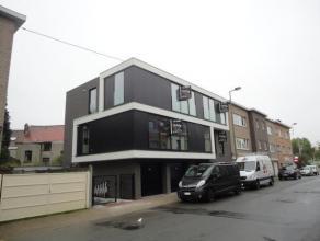 Strombeek-Bever (réf 714) Dans un petit immeuble neuf superbe appartement au 1er étage droit comprenant hall d'entrée, beau livin