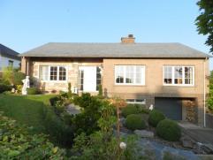 Instapklare, gelijkvloerse open bebouwing met een verzorgde tuin en garage, gelegen langs de Bloemenstraat 15 te Kumtich Tienen, met een totale percee