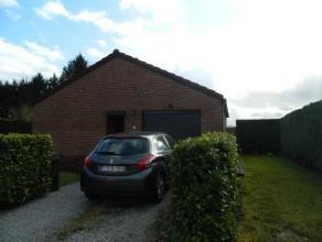 Charmant plain-pied 4 façades avec garage et jardin, situé dans un endroit calme et verdoyant tout en étant proche de la route de