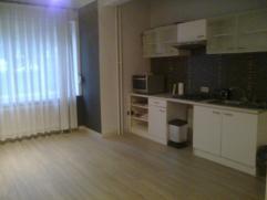Appartement 1 chambre - rez-de-chaussée - +/- 52 m2 , comprenant: - hall d'entrée avec débarras (dressing) - living avec cuisine
