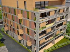 Nieuwbouw penthouse met groot half overkapt zuid west terras van 66 m2 met prachtig zicht kant station over Ieper en omstreken - ruime living met gash