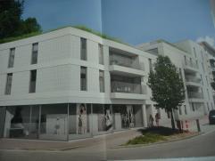Nieuwbouw appartement met 2 slpks. en ruime garage in het centrum van Genk.  Het betreft een mooi modern appartement met 112 m² binnenruimte + 13 m² t