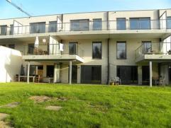 Nieuwbouw gelijkvloers appartement met zicht op de Leie.Het appartement is zonet opgeleverd en is gelegen op het gelijkvloers.Totale bewoonbare opperv