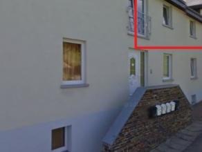 Bel appartement lumineux (+- 70 m² habitables) avec parking et jardin commun, situé au calme, à proximité du centre-ville de