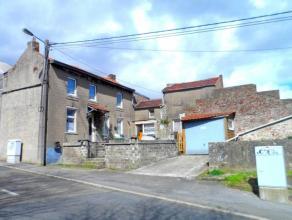 Lot de 2 petites maisons avec garage à rénover entièrement sur un terrain de 11a bien situé dans le centre à proxim