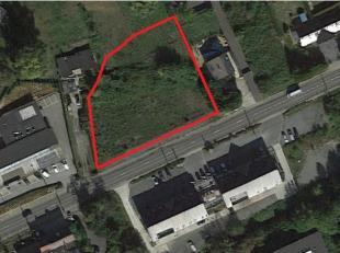 A vendre terrain de +/-2.300 m² situé dans une zone d'environnement mixte de commerce et d'habiations sur un axe principal proche des axes